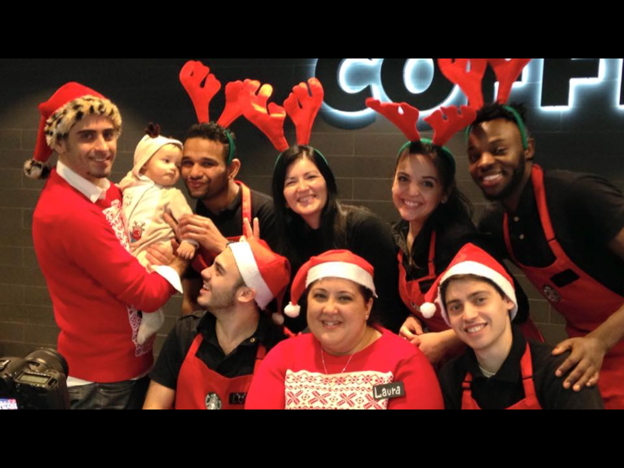 Starbucks staff dressing up at Christmas.