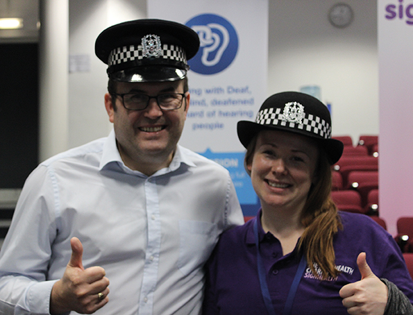 Hannah and policeman with thumbs up.