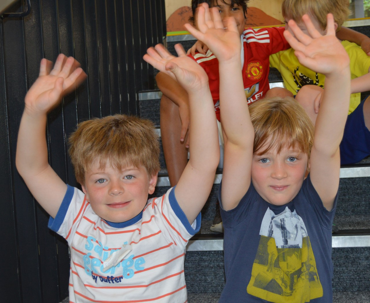 Boys with hands up Davenies school holiday club.